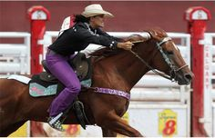 Barrel racer Fallon Taylor from Whitesboro, TX. rounded the barrel aboard her horse and posted a time of 17.57 seconds during the Calgary Stampede Barrel Racing Championship on July 9, 2013