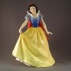 Snow White LE Royal Doulton Figurine This Royal Doulton figurine was designed by P. Parsons and is 8.25 inches or 21 cm in height. Snow White was issued in 1995 in a limited edition of 2000. She is wearing a yellow blue and red dress and is part of the Disney Princess Collection. HN 3678