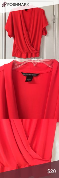 "Victoria's Secret Bright Coral Cross-front Blouse Stunning! Show off your tan in this beautiful Victoria's Secret Bright Coral Cross-front Blouse. Great condition! Polyester/Spandex blend. Bust 38"", waist 32"", length 24"". Kimono style sleeves. Spring, summer. Victoria's Secret Tops Blouses"