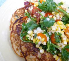 ... Cakes with a Medley of Roasted Corn, Cherry Tomatoes, Bacon & Arugula