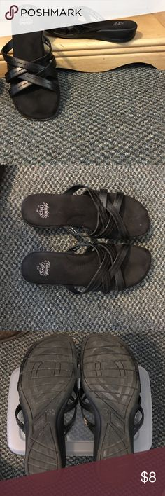 Black criss cross sandals size 9 Wide Black sandals size 9W. Cross cross straps look like leather, foot bed feels like suede. All man made material. No toe separator and very comfortable shoes. Excellent used condition. Faded Glory Shoes Sandals