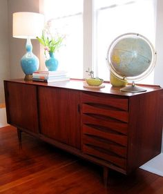 A couple of years ago I inherited the Danish modern credenza that had been sitting in my grandmother's living room for at least my entire life.  She took incredible care of it and so I've tried to do the same.  This means dusting, coasters and frequent oiling: