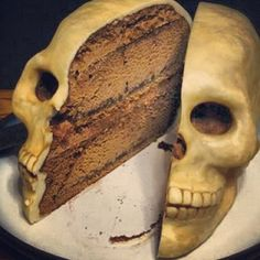 Skull cake. Use Wilton skull pan. Try a chocolate cake with chocolate mousse. Wrap in white chocolate fondant and dust with cocoa powder.