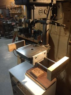 Drill press work support by jkahn - After years of dragging a support roller over to the drill press, it finally dawned on me there was an easier way.Fortunately my drill press table had parallel sides so making the support only took a couple hours work with metal from the scrap bin. I have been using this for about 8 years and never had to remove it because it got in the way.