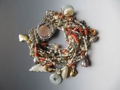 Shell hishi, old coral, moss aquamarine, silver, pearls, assorted charms. LuciaAntonelli.com