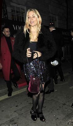 Sienna Miller looks in high spirits at Vogue fashion bash | Daily Mail Online