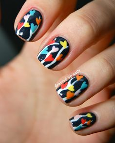 | Multicolor heart tree branches nail art. |