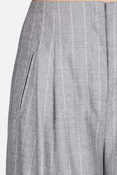 The fall 2016 Protagonist collection—the first under design director Georgia Lazzaro—evolves from lean, masculine proportions to eased, feminine shapes. The latter silhouette holds sway in these wide-legged striped trousers. Tailored of smoothly draping wool with a hint of stretch, they are framed by a clean waistband and paired reverse pleats. Finished with angled side welt pockets and back welt pockets, the zip-fly style is a fluid foil for a tailored jacket and pairs beautifully with…