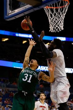 Montrezl Harrell #24 of the Louisville Cardinals blocks a shot by Michael Alvarado #31 of the Manhattan Jaspers during the second round of t...