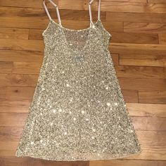 Free people gold sequin long cami size small Intimately by free people long gold sequin Cami with adjustable straps. Worn twice. Size small. In great condition Free People Tops Camisoles