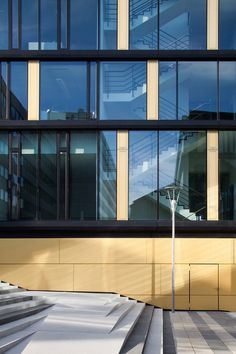 The office facade - Vertical story-high glass panels alternate with room-high…