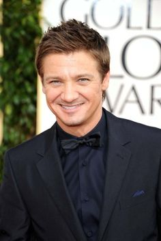 its ok Jeremy Renner doesn't have a beard or any visible tattoos, the bow tie makes up for it.