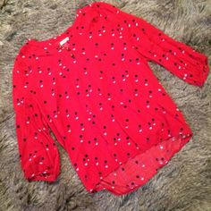 "Red polka dot top This breezy top has a loose fit, elastic at the waist, gathered material at the shoulders, three buttons at the neck. Black, cream, and pink polka dots on a red background. L:22"",  B:20.5"", S:16.5"". Old Navy Tops Blouses"