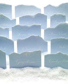 Snowbanks of rock salt and frosty mountains fashioned from torn paper and dusted with a sprinkling of glistening glitter turn a table number display into a frozen landscape.