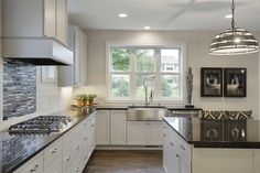 This white kitchen features a custom millwork hood, glass tile, stainless farm sink and lots of windows. Custom Home Builders, Custom Homes, Dream Home Builder, Lots Of Windows, Farm Sink, Home Kitchens, Luxury Homes, Tile, Contemporary