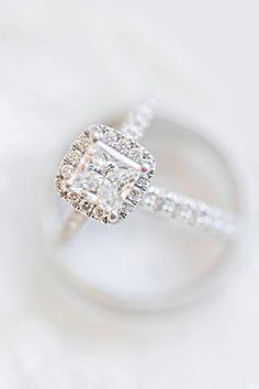 This princess cut diamond engagement ring features a cushion halo and matching wedding band #princess #princessdiamond #princesscut #halo #engagementring #ring #weddingband