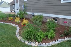 bed landscape edging | Mix and match stone shapes and colors for a natural edge. Positioned ...