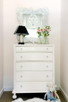 Painted the dresser the same color as the walls, except in a high gloss finish. Added glass knobs. - Chloe's room?