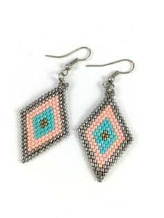 ***HANDMADE*** Miyuki Bead Brick Stitch Earrings I have chosen for this earrings is high quality aqua, light pink, copper and silver color miyuki sead beads made with brick stitch technique . Elegant Boho earrings for day or night. Measurements: 4 cm drop * Would you LOVE to own this and