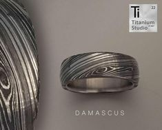 Titanium inner ring with full Damascus steel sleeve.