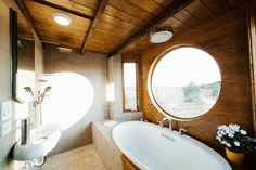 The Monocle: a stunning, luxury tiny house from Wind River Tiny Homes of Chattanoog, TN. I love so many things about this tiny house but this bathroom with it's soaker tub AND shower is above and beyond my wildest tiny dreams.