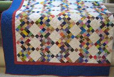 """Rick Rack Nines and is from Bonnie Hunter's book Leaders and Enders. Bonnie says it is a Big quilt and she was right but it was quite easy to make using the leader ender method. The quilt used 2,670 - 2"""" squares to make the nine patch blocks."""