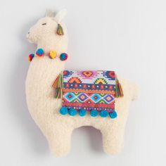 This adorable throw pillow is in the shape of a llama wearing a colorful blanket with blue pom-poms and a pom necklace. With a fuchsia back, this soft pillow is a fun accent to your home decor. affiliate