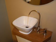 Add a toilet-top sink and re-use your gray water to flush the toilet. This tutorial shows you how to do it for much cheaper than the retail product that's out there.