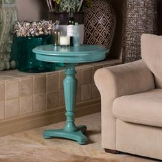 The distressed blue weather worn appearance of this accent table brings a traditional refinement to your decor. The turned pedestal base with fluted details accents your home with timeless elegance.
