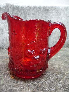 *VINTAGE RED PICHER ~ would be perfect as a creamer. Striking red glass with cherry pattern, quite heave and sturdy.