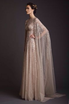 "Gorgeous beige light pink nude colored long cape gown with gradient ""ombre"" ssequis for just enough sparkle effect. Covered shoulders,  classy Greek-inspired"