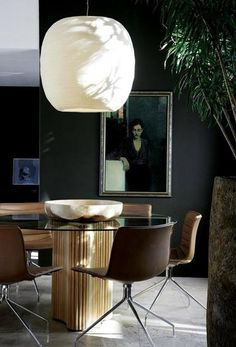 Dark walls contrast 1960's style table & chairs, creates modern interior vibe