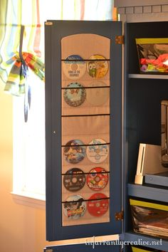 Disk storage right on the door of your entertainment center. Beckie at Infarrantly Creative has a great tutorial.