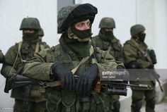 Soldiers who were among several hundred that took up positions around a Ukrainian military base stand near the base's periphery in Crimea on March 2, 2014 in Perevalne, Ukraine. Several hundred heavily-armed soldiers not displaying any idenifying insignia took up positions outside the base and parked several dozen vehicles, mostly trucks and patrol cars, nearby. The new government of Ukraine has appealed to the United Nations Security Council for help against growing Russian intervention in…