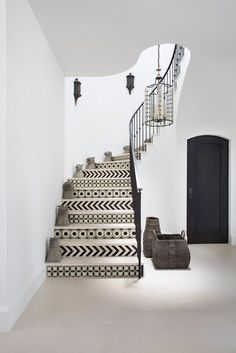 This contemporary Los Angeles house is rich with Moroccan accents, and the stairway offered yet another area to explore the exotic. Designer Betsy Burnham shares four ways her firm has used a stairwell as an opportunity to step up a home's design | archdigest.com