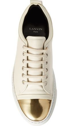 305f543a6f A metallic cap toe adds an extra flash of glamour to this low-top sneaker