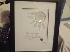 You are my Sunshine! is an original sea glass design featuring a complete bottle bottom for the round sun. Hand lettering and a heart rock finish the piece that is in a black 9 x 11 shadowbox frame. As with all of my artwork, each piece is an original and once that piece is sold, I can create a custom duplicate - made to order and includes the matting and frame, making it a complete piece; perfect for gift giving. Each piece pictured is the original and your custom piece will be as close to…
