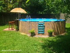 Our little piece of backyard paradise, camouflaged the pool with reed fencing and added diy pallet tiki bar and cute tiki umbrella.: