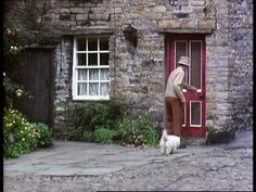 Pride Of Possession (1978) Cottage in Market Place, Askrigg, Wensleydale, North Yorkshire - The home of painter, Mr Roland Partridge & his dog, Percy.