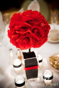 Red floral centerpiece with black beans or coffee beans! Such a creative idea!
