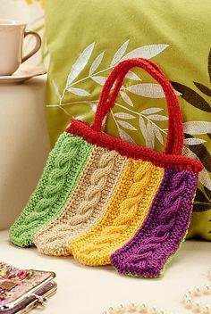 Ravelry: Cabled bag pattern by Wendy Mould - happy and bright :)