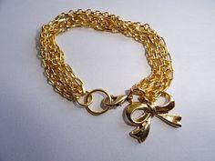 Chevi Biju: Pulseira lacinho dourada