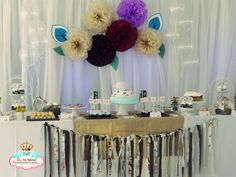 Fabric garland and dessert table at a chic rustic birthday party! See more party planning ideas at CatchMyParty.com!