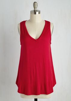 Every fashionista needs pieces in their wardrobe that can be infinitely styled, and this ultra-soft red tunic promises unlimited options. With a simple V-neck and high-low hem, this top can take your look from casual to classy in a breeze!