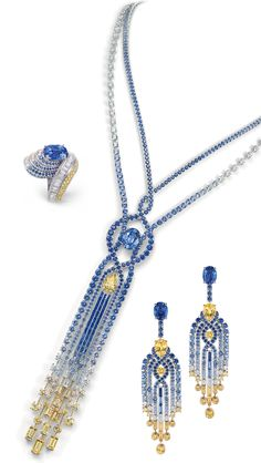 On the right you see a pair of earrings set with diamonds, round and baguette-cut blue and yellow sapphires, two pear-shaped yellow sapphire...