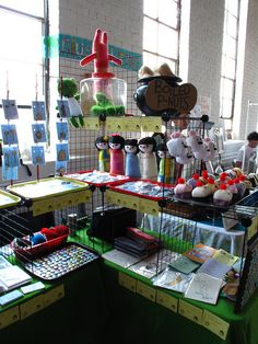Wire cubbies: Great use of vertical space. {craft booth setup}