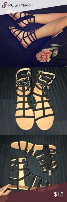Black Gladiator Sandals NWOT size 7 gladiator sandals. Faux suede. Has a zipper on the inner part of the sandals. Wet Seal Shoes Sandals