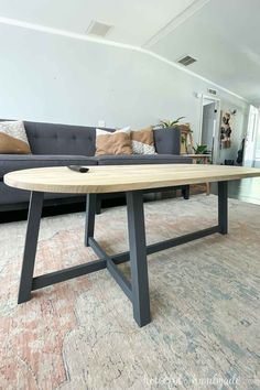 Build a beautiful asymmetrical coffee table with a modern open base and rounded top. Get the build plans from Housefulofhandmade.com. #CoffeeTable #DIY #WoodWorking Family Room Decorating, Cool Coffee Tables, Diy Furniture Plans, Building Plans, Home Look, Diy Woodworking, Diy Home Decor, Design Ideas, Diy Projects