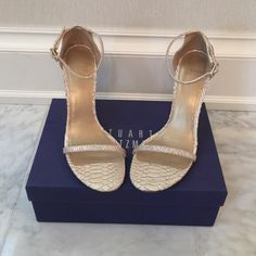 NEW Stuart Weitzman Python Ivory Heels 9.5 Absolutely stunning!!! These shoes are brand new, never worn. Came to me with a little marking on the bottom. They come with the box. Size 9.5. Purchased from Saks. Stuart Weitzman Shoes Heels