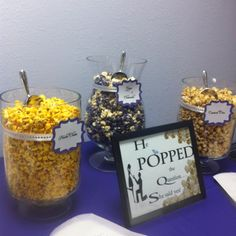 He Popped the question- she said yes! Popcorn bar with assortment of flavored popcorns, gourmet popcorn and popcorn spices for sprinkling on top.